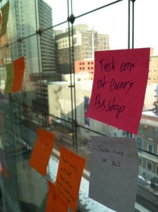 Students' observations about trash and litter in Philadelphia were handwritten on colorful sticky notes and posted on the windows of the rooftop Hamilton Garden at the Kimmel Center for the Performing Arts.