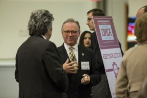 Fox School of Business Dean M. Moshe Porat speaks with Istvan Varkonyi, Director of Temple University's General Education Program, Office of the Senior Vice Provost, at the 2014 Innovative Idea Competition.