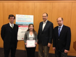 Fox School Management Information Systems professors James Moustafellos, far left, and David Schuff, far right, recognize Tyler School of Art student Cassandra Reffner as the winner of the 2014 Temple Analytics Challenge. Third from left is Doug Seiwert, Vice President of Information Technology at QVC, who served as the event's keynote speaker.