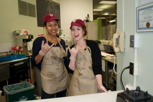 Employees Elizabeth Eckley and Mariam Dembele dish out vegetarian fare at Rad Dish Café's grand opening in February 2015. (Photo by Allie Guerin)