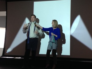 Fox School students Eric Hamilton and Brooke Lehman offer tips on how to properly pull off accessories, like tying a neck tie and wearing a decorative scarf, during CSPD's Work Your Wardrobe event.