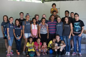 Members of Fox School student Brandon Study's non-profit, Into The Nations, pose for a photo with El Salvadorans on a recent visit. (Courtesy Brandon Study)