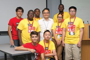 Photo of Dr. Youngjin Yoo (center) with students from Temple University's Urban Apps & Maps Studios