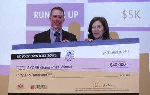 Ellen Weber, right, Executive Director of Temple's Innovation and Entrepreneurship Institute, awards Ben Stucker, MBA '13, the grand prize of the 2015 Be Your Own Boss Bowl.