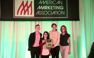 Fox Marketing students Alexander Brannan, Lily Tran, Abbey Harris, and Rachel Baker hold their first-place plaque after winning the American Marketing Association's Collegiate Case Competition.