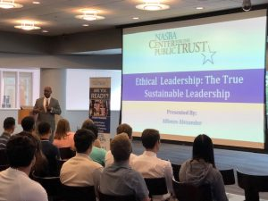 "Alfonzo Alexander with project screen reading ""Ethical Leadership: The True Sustainable Leadership"""