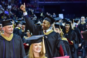 Graduate gives family thumbs up at Fox School of Business winter graduation