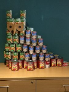 Donated cans in the shape of an owl